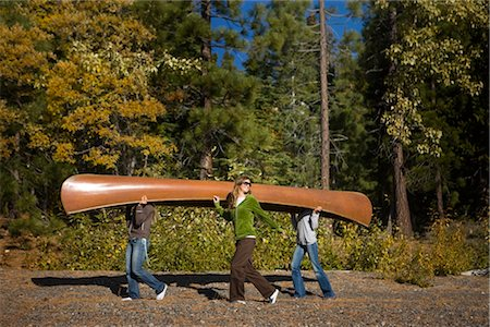 Three Women Carrying Canoe in the Forest Stock Photo - Premium Royalty-Free, Code: 600-02386118