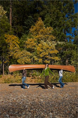 Three Women Carrying Canoe in the Forest Stock Photo - Premium Royalty-Free, Code: 600-02386119