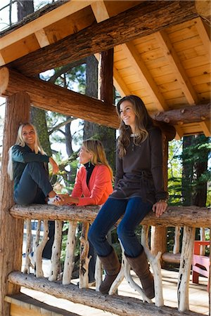Three Women Hanging Out at Cottage Stock Photo - Premium Royalty-Free, Code: 600-02386120