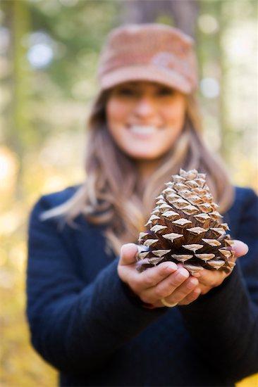 Woman Holding Cone of Ponderosa Pine Stock Photo - Premium Royalty-Free, Artist: Ty Milford, Image code: 600-02386136