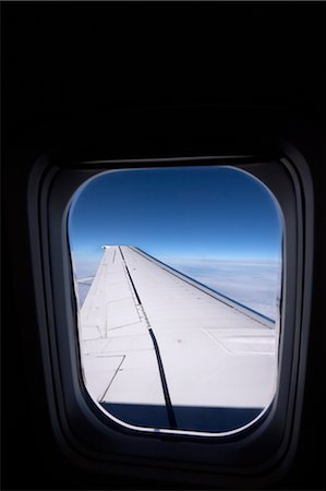 View of Wing from Airplane Window Stock Photo - Premium Royalty-Free, Code: 600-02428490