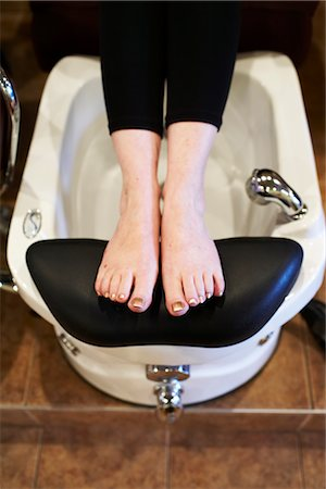 Close-up of Woman Soaking Her Feet at the Spa Stock Photo - Premium Royalty-Free, Code: 600-02429206