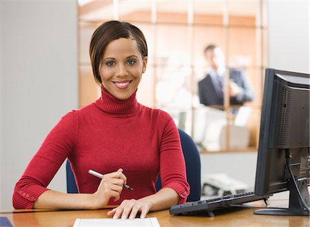Portrait of Businesswoman at Her Desk, Offering Contract Stock Photo - Premium Royalty-Free, Code: 600-02447815