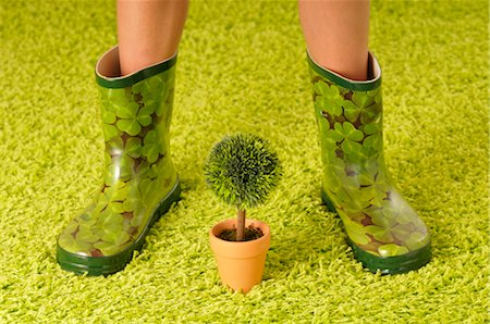 Woman in Rubber Boots with Potted Plant Stock Photo - Premium Royalty-Free, Code: 600-02519117