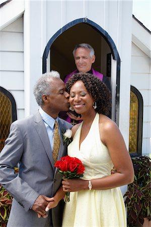 Groom Kissing Bride Outside Chapel, Niagara Falls, Ontario, Canada Stock Photo - Premium Royalty-Free, Code: 600-02519146