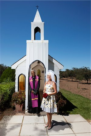 Bride and Priest Standing in Front of Church, Niagara Falls, Ontario, Canada Stock Photo - Premium Royalty-Free, Code: 600-02593701