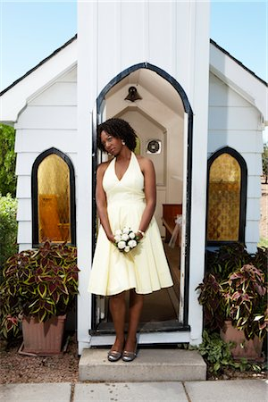 Woman with Bouquet Standing in Doorway of Quaint Church, Niagara Falls, Canada Stock Photo - Premium Royalty-Free, Code: 600-02593703
