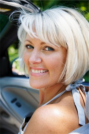 Woman Looking Over Shoulder Stock Photo - Premium Royalty-Free, Code: 600-02593710