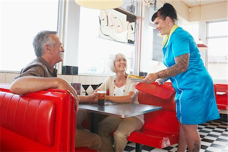 roller skate - Waitress Serving Customers in Retro Diner Stock Photo - Premium Royalty-Free, Code: 600-02593724