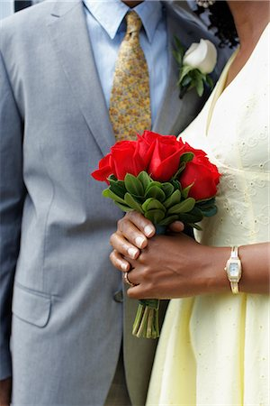 Close-up of Bride Holding Bouquet of Roses, Niagara Falls, Ontario, Canada Stock Photo - Premium Royalty-Free, Code: 600-02593742