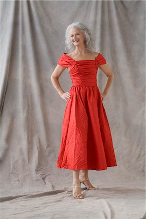 Mature Woman Wearing Red Dress Stock Photo - Premium Royalty-Free, Code: 600-02593825