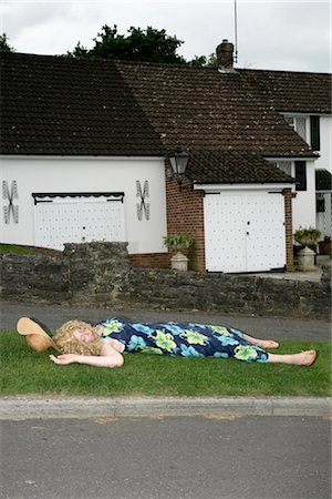 Woman Unconscious at Side of Road Stock Photo - Premium Royalty-Free, Code: 600-02637242