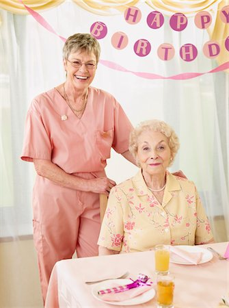 Birthday Party in Retirement Home Stock Photo - Premium Royalty-Free, Code: 600-02637668