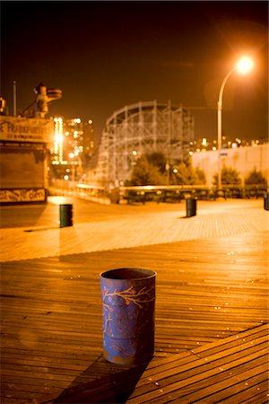 Trash Can on Boardwalk at Night, Luna Park, Coney Island, New York City, New York, USA Stock Photo - Premium Royalty-Free, Code: 600-02637802