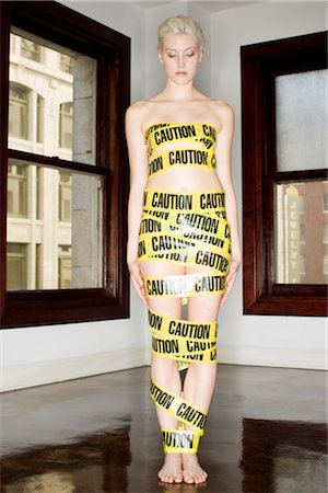 restrained - Woman Wrapped in Emergency Tape, Los Angeles, California, USA Stock Photo - Premium Royalty-Free, Code: 600-02637973
