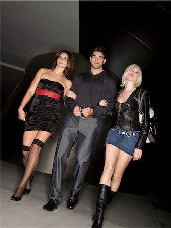 Women Leading Handcuffed Man, Los Angeles, California, USA Stock Photo - Premium Royalty-Free, Code: 600-02637980