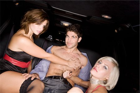 Women Undressing Man in Back of Limousine Stock Photo - Premium Royalty-Free, Code: 600-02637981