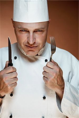 Portrait of Chef Holding Knife and Fork Stock Photo - Premium Royalty-Free, Code: 600-02659653
