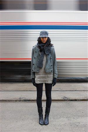 Woman Standing Near Speeding Train, Portland, Oregon, USA Stock Photo - Premium Royalty-Free, Code: 600-02659825