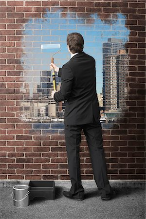 Businessman Painting Cityscape on Brick Wall Stock Photo - Premium Royalty-Free, Code: 600-02659992