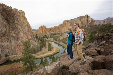 Hikers Standing on a Cliff Above Crooked River in Smith Rock State Park in Autumn, Bend, Oregon, USA Stock Photo - Premium Royalty-Free, Code: 600-02669360