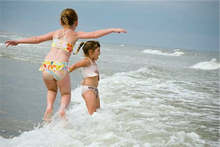 Girls Playing in Waves, Cape Hatteras, North Carolina, USA Stock Photo - Premium Royalty-Free, Code: 600-02660010