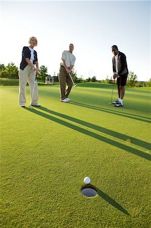 Group of People Playing Golf, Burlington, Ontario, Canada Stock Photo - Premium Royalty-Free, Code: 600-02670294