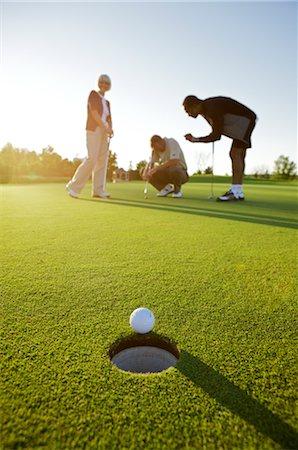 Group of People Playing Golf, Burlington, Ontario, Canada Stock Photo - Premium Royalty-Free, Code: 600-02670295