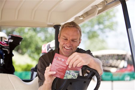 scoring - Man with Score Card in Golf Cart Stock Photo - Premium Royalty-Free, Code: 600-02670417