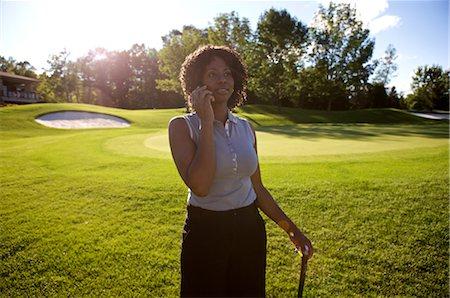 Golfer with Cellular Phone, Burlington, Ontario, Canada Stock Photo - Premium Royalty-Free, Code: 600-02670435