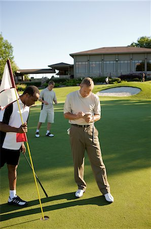 Men Golfing, Burlington, Ontario, Canada Stock Photo - Premium Royalty-Free, Code: 600-02670453