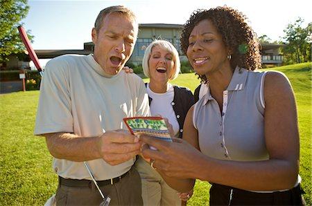 Golfers Looking at Score Card, Burlington, Ontario, Canada Stock Photo - Premium Royalty-Free, Code: 600-02670462
