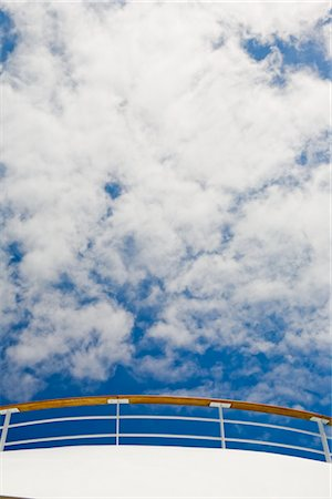 Sky and Clouds above Railing of Cruise Ship Stock Photo - Premium Royalty-Free, Code: 600-02671107