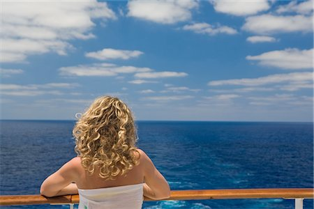 Woman Looking at Ocean from Rear of Cruise Ship Stock Photo - Premium Royalty-Free, Code: 600-02671109