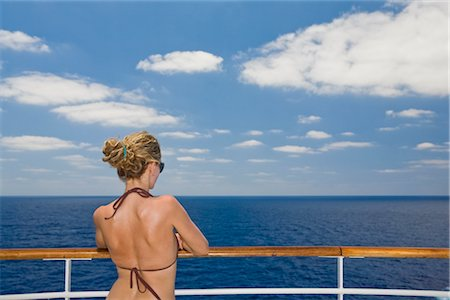 Woman in Bikini Looking at Horizon from Cruise Ship Stock Photo - Premium Royalty-Free, Code: 600-02671115