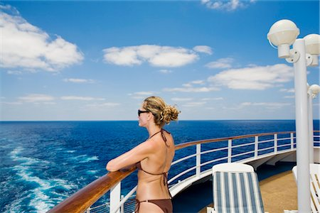 Woman in Bikini Looking at Ocean from Stern of Cruise Ship Stock Photo - Premium Royalty-Free, Code: 600-02671117