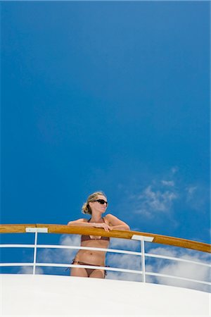 Woman Wearing Bikini Leaning on Railing of Cruise Ship Stock Photo - Premium Royalty-Free, Code: 600-02671113