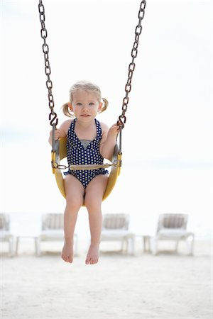 Girl Wearing Bathing Suit in Swing on Beach, Cancun, Mexico Stock Photo - Premium Royalty-Free, Code: 600-02686150