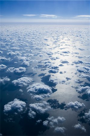Aerial View of Clouds and Blue Sky Over Pacific Ocean Stock Photo - Premium Royalty-Free, Code: 600-02694416