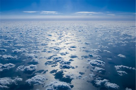 Aerial View of Clouds and Blue Sky Over Pacific Ocean Stock Photo - Premium Royalty-Free, Code: 600-02694417