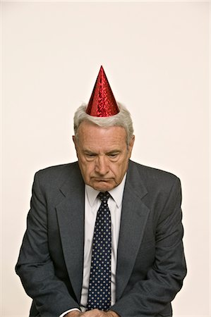 Businessman Wearing Party Hat Stock Photo - Premium Royalty-Free, Code: 600-02694644