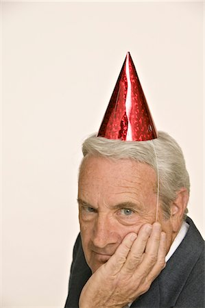 Businessman Wearing Party Hat Stock Photo - Premium Royalty-Free, Code: 600-02694643