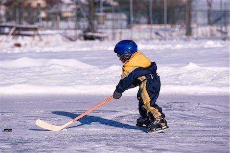 Little Boy Playing Hockey on a Frozen Pond, Fuschlsee, Salzburger Land, Austria Stock Photo - Premium Royalty-Free, Code: 600-02700182