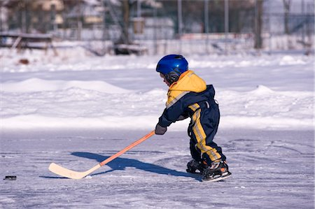 Little Boy Playing Hockey on a Frozen Pond, Fuschlsee, Salzburger Land, Austria Stock Photo - Premium Royalty-Free, Code: 600-02700182
