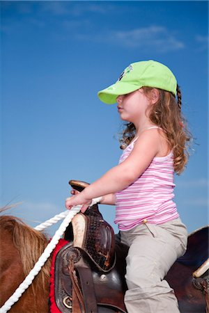 Girl Horseback Riding in the Black Hills, Custer State Park, South Dakota, USA Stock Photo - Premium Royalty-Free, Code: 600-02700350