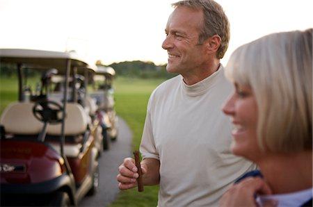 Couple on Golf Course, Burlington, Ontario, Canada Stock Photo - Premium Royalty-Free, Code: 600-02701098