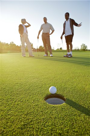 Friends Playing Golf, Burlington, Ontario, Canada Stock Photo - Premium Royalty-Free, Code: 600-02701189