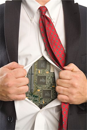 Businessman Opening Shirt to Reveal a Computer Motherboard Stock Photo - Premium Royalty-Free, Code: 600-02757051