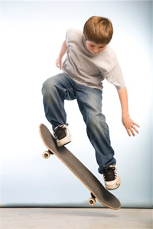 Skateboarder Doing an Ollie Stock Photo - Premium Royalty-Free, Code: 600-02757070