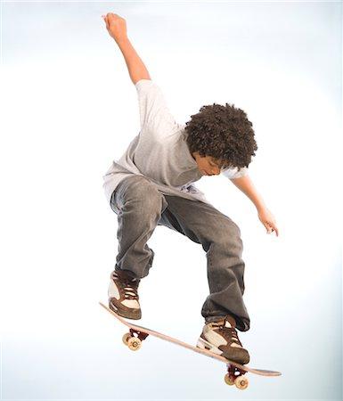 Skateboarder Doing an Ollie Stock Photo - Premium Royalty-Free, Code: 600-02757071